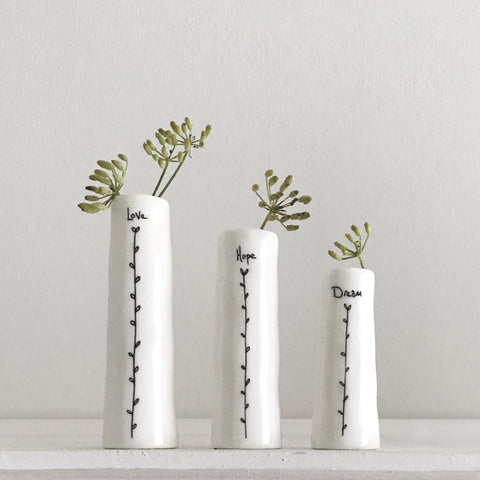 A set of three lovely porcelain bud vases in three different sizes. A beautiful present for Mothers Day, family or friends.  Size 11.5 x 12.5 x 3.5cm