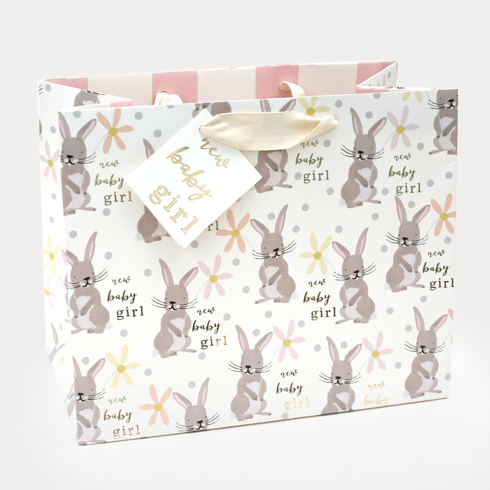 A gorgeous contemporary landscape gift bag printed on thick paper with a matt coating, and a matching gift tag. Features a repeat pattern of cute bunnies.  H225 x W275 x D150 mm