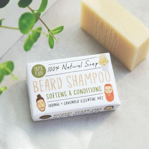A 100% natural, plastic-free beard shampoo and shave bar for naturally rugged faces.  This handmade, vegan bar creates a smooth rich lather, which nourishes and softens beards and makes for a soothing shaving lather.  Perfect for a quick shave in the shower or bath, or a longer, luxurious shave with a sink full of steaming hot water.  The paper packaging is secured with biodegradable clear stickers.  No plastic. No palm oil. No sulphates. No triclosan. No phthalate. No cruelty. No worries.