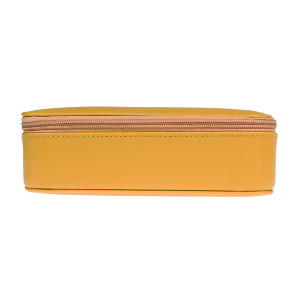 This stylish and practical mustard yellow Bees Jewellery Case has plenty of compartments for your jewellery and comes with a bee shape and 'Busy As A Bee' debossed on the lid.  Faux leather Elastic pouch 4 rose gold popper loops Solid mustard yellow with textured surface 6(H) x 20(W) x 10cm(D) Rose gold zip