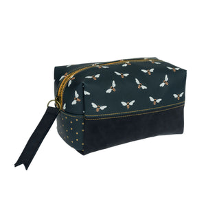 This beautiful bee wash bag is made from faux leather and faux suede and features a range of Sophie's popular bees on a navy background. The words 'Busy As A Bee' is written on the zip. This lovely bag makes a great gift and is perfect for keeping your makeup, toiletries and accessories together.  Dimensions 20cm (l) x 12cm (h) Made from faux leather and faux suede  The words 'Busy As A Bee' written on the zip