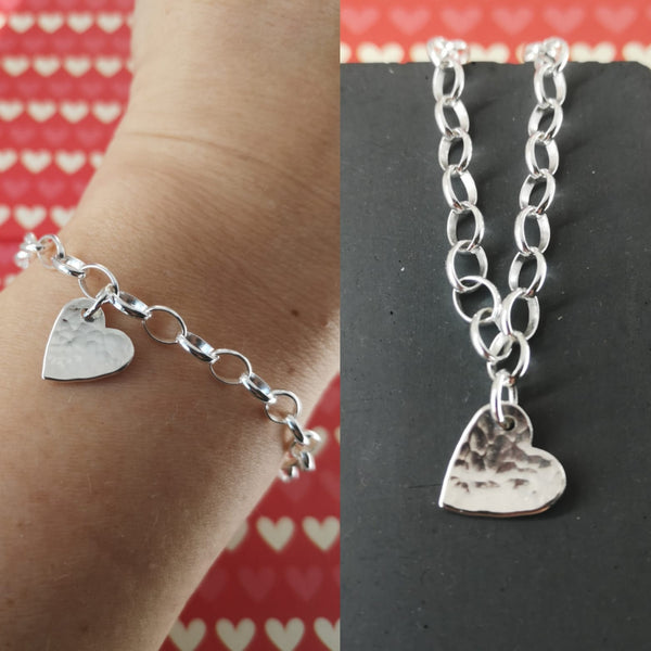 Silver heart bracelet, hammered & slightly domed. The heart measures 13mm & hangs on an belcher chain. Handmade in Halifax by jeweller Ami Hallgarth.