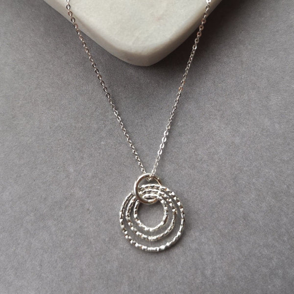 This stunning necklace is made from textured silver which catches the light and shimmers beautifully. The largest circle measures about 1cm. Another gorgeous piece by Halifax based jeweller, Ami Hallgarth. Comes complete with box.
