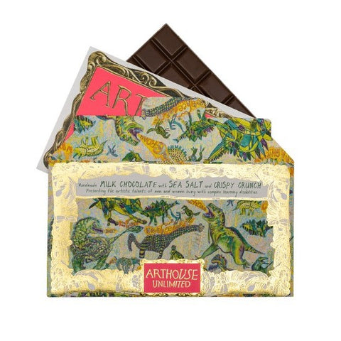 Handcrafted in the UK by a specialist chocolatier using cocoa beans from the Dominican Republic, this chocolate is an indulgent treat for the taste buds. This chocolate features artwork created by a collaboration of ARTHOUSE Unlimited artists.   This ferociously colourful collaborative Dinosaur design decorates a delicious sea salt infused crispy crunch chocolate experience.  Handmade in the UK Minimum weight 100g 7.5cm (w) x 16cm (h) Ingredients: Sugar, Cocoa Solids 36%, Whole Milk Powder (MILK), Cocoa But