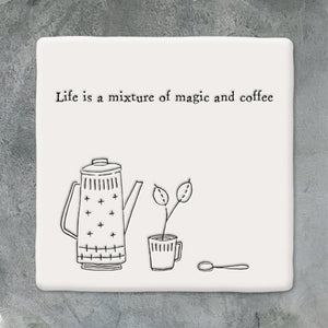 Beautiful white porcelain coaster from East of India with the words 'Life is a mixture of magic and coffee'.  10x10cm with white felt backing to protect your surfaces.