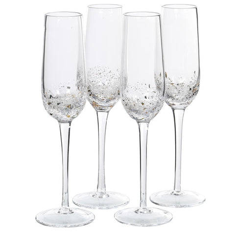 A set of four champagnes flutes with small glass bubbles embedded in the glass at the bottom of the flute. Some of the bubbles contain flecks of gold. These would make a gorgeous present for many occasions-valentines, wedding, mothers day or just a lovely birthday present with a bottle of fizz!