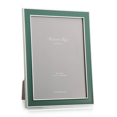 "This exclusive Addison Ross designed fern green enamel and silver 15mm frame sets off both colour and black and white photos beautifully. Group them to make an impressive statement. Able to stand both Landscape and Portrait.  Silver plate with fern green enamel, backed with light grey luxury velvet. Keep dry, clean with a duster.   Size 4"" x 6"". The size refers to the size of the photo within the frame, there is usually an overlap of approximately 5mm."