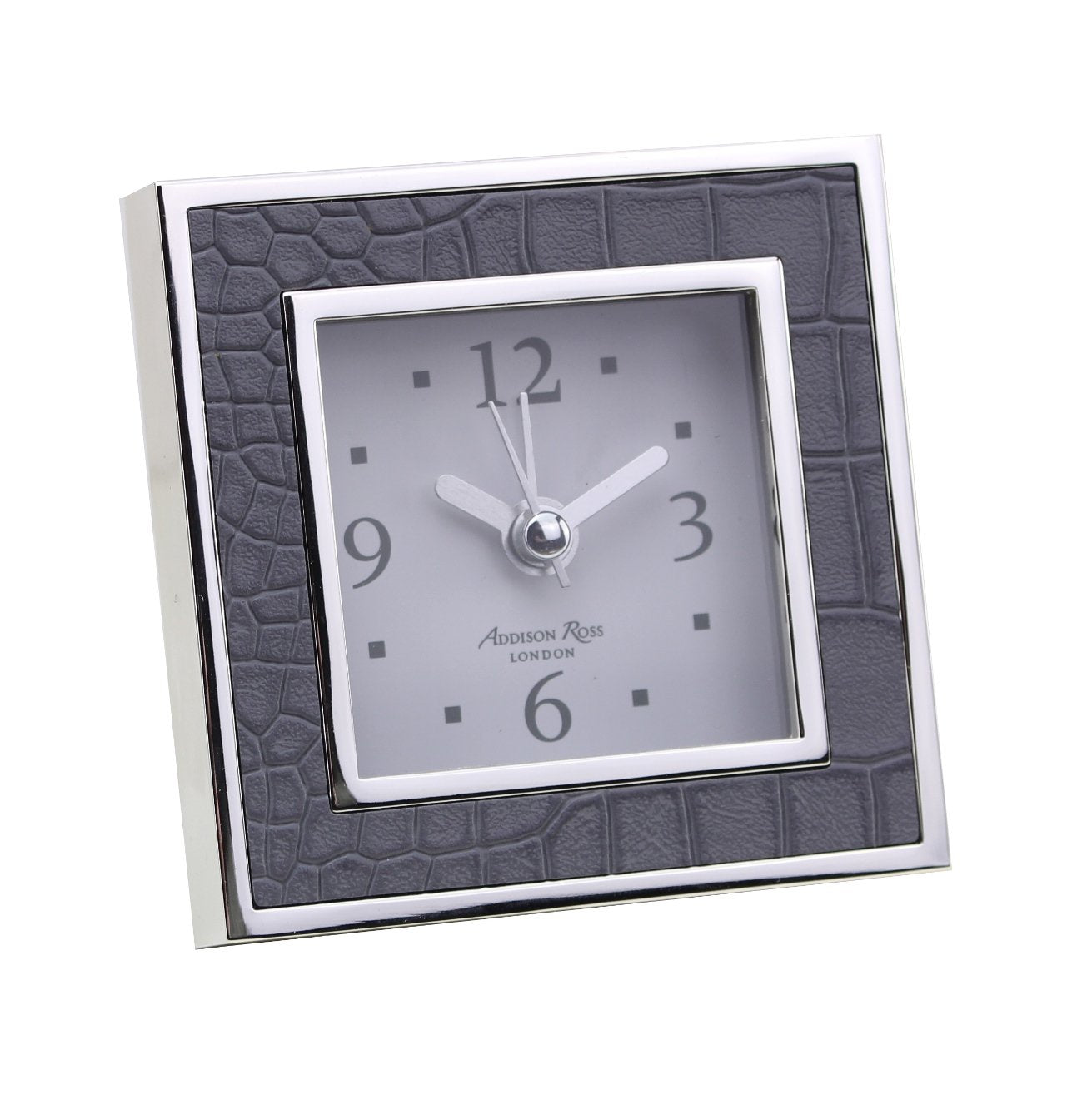 This lovely grey faux croc enamel square alarm clock beautifully complements many of the Addison Ross picture frames. Complete with an alarm function, this clock is ideal for a bedside table or desk. Backed in black velvet with a silver clock movement cover.  This clock features a silent sweep movement making it the perfect addition to a bedside table.  Requires 1 AA battery. Keep dry, clean with a duster. Measures 8cm x 8cm x 5.5cm (including leg) Beautifully packed in a branded box and tissue paper.