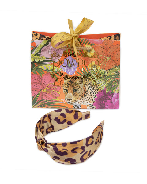 Remind your colleagues that you have a wild side with this Leopard Print Satin Headband, no need to think about changing your spots! Style with ANYTHING, from black to clashing prints, leopard will work wherever, whenever. Delivered with complimentary, limited edition Powder gift packaging.  Measurement: one size Fabric: 100% polyester
