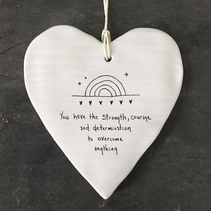 This pretty East of India porcelain hanging heart features the sentiment 'You have the strength, courage and determination to overcome anything' and would make a thoughtful gift and a wonderful decorative addition to any home.  Size:10 x 9 x 0.5cm
