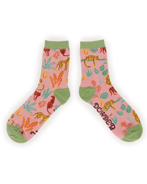A pair of funky, colourful jungle print socks from Powder. These will be sure to brighten anyone's day!  Measurement: Ladies Shoe Size 4-9 UK Fabric: 65% Bamboo, 15% Cotton, 10% Nylon, 10% Elastane