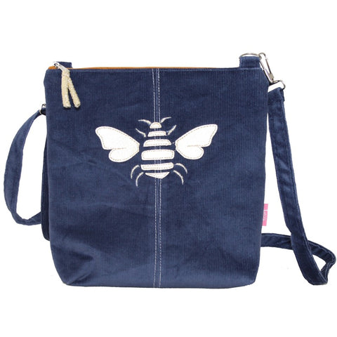 A cross body messenger bag with a golden bee appliqued in faux leather snakeskin - now in velvety corduroy a in gorgeous navy blue colour.  A percentage of the profits on this range will go to Rewilding Britain, the UK based organisation aiming to re wild many parts of the UK and return it to nature.    Size 23cm x W 22cm