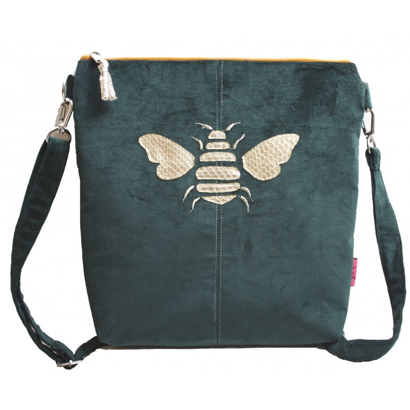 A cross body messenger bag with a golden bee appliqued in faux leather snakeskin - now in velvety corduroy a in gorgeous green colour.  A percentage of the profits on this range will go to Rewilding Britain, the UK based organisation aiming to re wild many parts of the UK and return it to nature.    Size 23cm x W 22cm