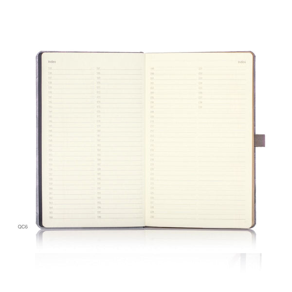 Oro notebooks feature luxury gold detailing, a gold ribbon marker and coloured closure band and pen loop detailing. The high quality features continue with black card front end papers and a document pocket in the back.  Castelli notebooks boast FSC certification and product traceability, confirming our committed approach to the care of the environment.