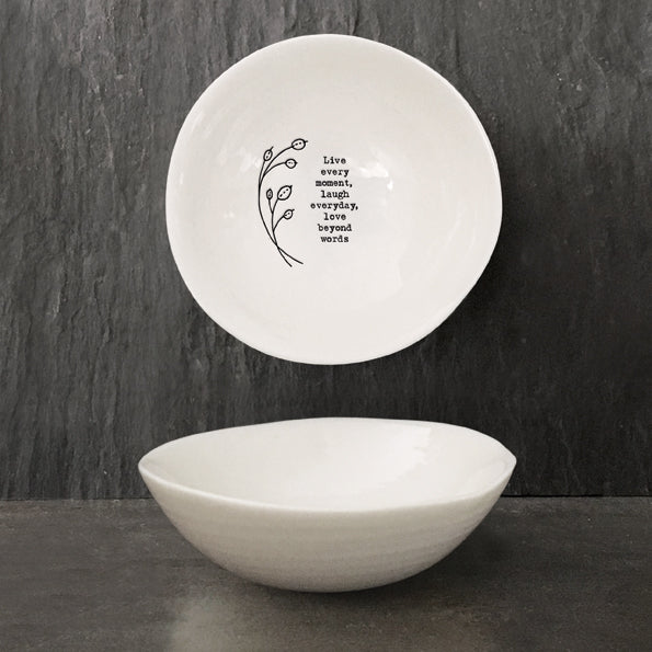 The design reads; 'Live every moment, laugh everyday, love beyond words' and has a floral design engraved alongside.  This white porcelain trinket dish has a wobbly rim and makes a great gift for a family member, friend or loved one to treasure forever. Perfect for holding the likes of rings, small trinkets and various other items, this dish can also be used for décor purposes as equally well, making a subtle addition to any coffee table, side board or kitchen work surface.  Size: 10cm x 10cm x 3.3cm