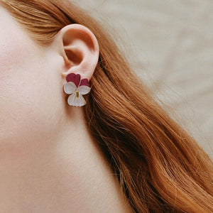 Mini illustrated violet studs with hand-inked detail. The Garden is a playful collection of acrylic and wood jewellery, inspired by colourful wildflowers and fruit found at the bottom of an enchanting, overgrown garden.  Comes in a W&M gift box.