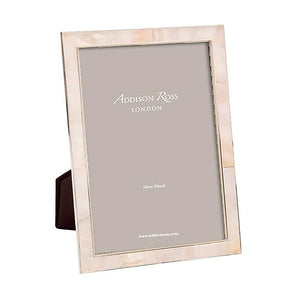 This exotic Mother of Pearl shell photo frame is understated and elegant, very popular for wedding gifts, anniversaries & birthdays as they complement any room.  With slide in black velvet backing. Keep dry, clean with a duster. Available for phoThis exotic Mother of Pearl shell photo frame is understated and elegant, very popular for wedding gifts, anniversaries & birthdays as they complement any room.  With slide in black velvet backing. Keep dry, clean with a duster. Available for photo sizes 5 x 7 in, 4