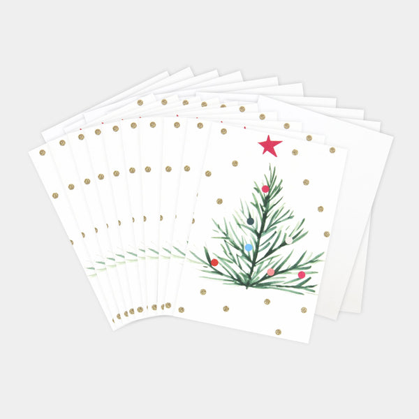 This pack of 10 mini Christmas cards features a painted decorative christmas tree and a showering of gold eco glitter. These fun and festive cards with luxury finishes are packaged in our environmentally friendly bags made of recycled bottles, that have replaced the cellophane this year!  Dimensions: 123mm x 83mm Pack of 10 cards with 10 white envelopes Message inside - 'merry christmas and a happy new year'  Made from low chlorine pulp board from sustainable forests and can be recycled Cellophane FREE Desi