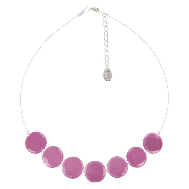 Bubbly, bright and fun-loving, these ceramic discs are both bold and strong in colour, making a fantastically sunny and cheerful accessory. Celebrate love of confident colour with this incredible necklace.