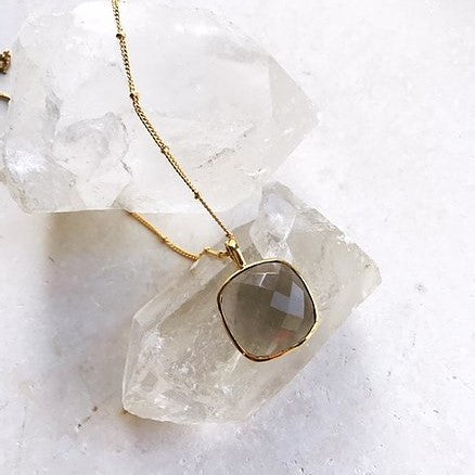 The Sabrina Necklace is formed of a perfectly square chalcedony stone on a long 22 inch slim and feminine chain with small gold balls running throughout.  Metal is 22 carat gold on sterling silver.