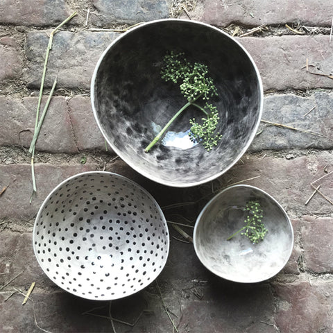 Presented in a simple grey box, these bowls come in three different sizes. The largest of the set has a dark taupe wash inside, the middle size has a paler taupe coloured wash with a polka-dot pattern and the smallest bowl has a pale taupe wash. Perfect for a range of things, from food to potpourri. A lovely present for a friend, family member or a gorgeous house warming gift.  Small Bowl – Height: 5cm, Diameter: 9.5cm  Medium Bowl – Height: 6cm, Diameter: 12.5cm  Large Bowl – Height: 7.5cm, Diameter: 15cm