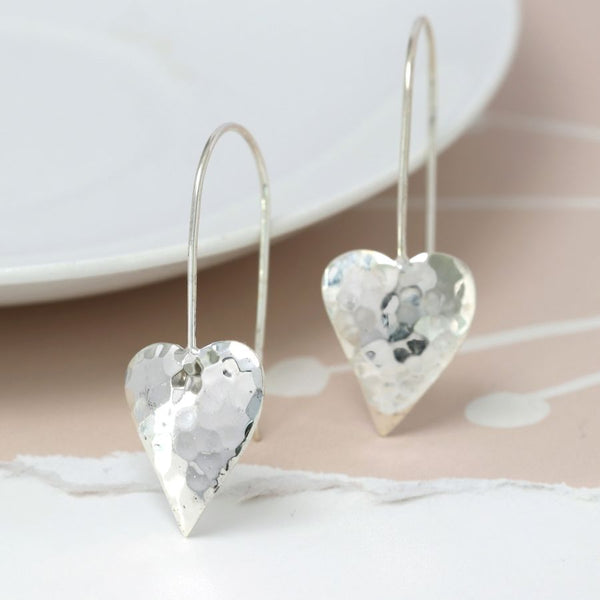 Sterling silver concave heart drop earrings with a hammered texture on long sterling silver hooks. Very elegant & can be worn day or night.