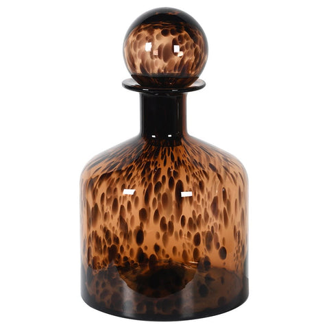 A gorgeous bottle with a tortoise shell design embedded into the glass. It would look beautiful on its own or alongside the tall tortoise shell bottle that we also have for sale. Dimensions: H:390 Dia:200 mm.