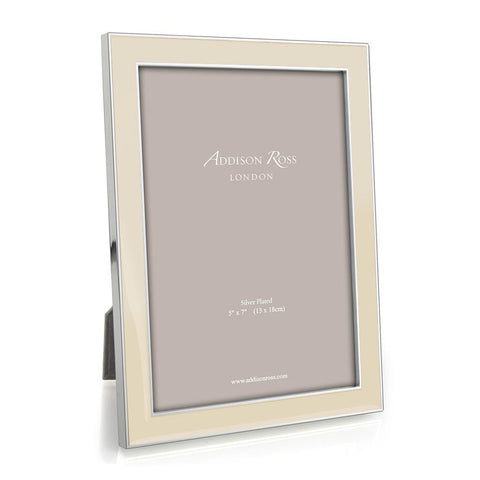 One of the heritage colours, this exclusive Addison Ross designed 15mm vanilla enamel and silver frame is subtle and stylish and will complement any classic modern interior.  Silver plate with vanilla enamel, backed with dark grey luxury velvet, 15 mm frame. Available in two sizes. Keep dry, clean with a duster.  The size refers to the size of the photo within the frame, there is usually an overlap of approximately 5mm.