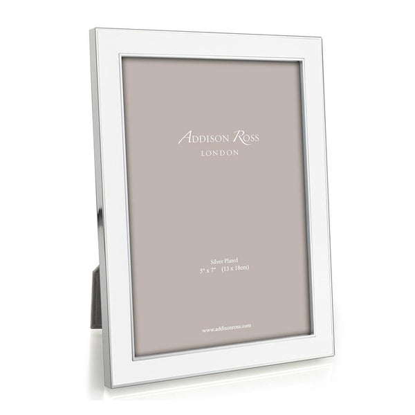 "This exclusive Addison Ross designed white enamel and silver frame sets off both colour and black and white photos beautifully. Very popular for wedding presents as it will go with any colour scheme. Group a collection of white frames together to create a beautifully tasteful display.  Silver plate with white enamel, backed with dark grey luxury velvet, 15 mm frame.  4""x6"". The sizing refers to the size of the photo within the frame, there is usually an overlap of approximately 5mm. Comes boxed."