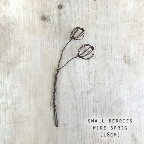 These beautifully crafted sprigs are handmade from wire, twisted to form adorable displays for the home.  Available in Cow Parsley, Bulrush or Berries.