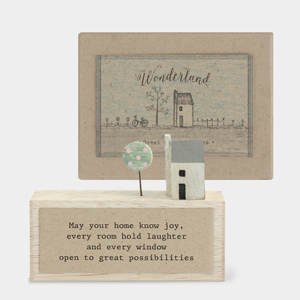 This handmade wooden scene shows a small white house alongside a tree on a wooden block. The writing underneath reads: 'May you home know joy, every room hold laughter and every window open possibilities'. Beautifully presented in a recyclable gift box, making for a lovely present.  Approx size 10.5 x 8 x 2cm