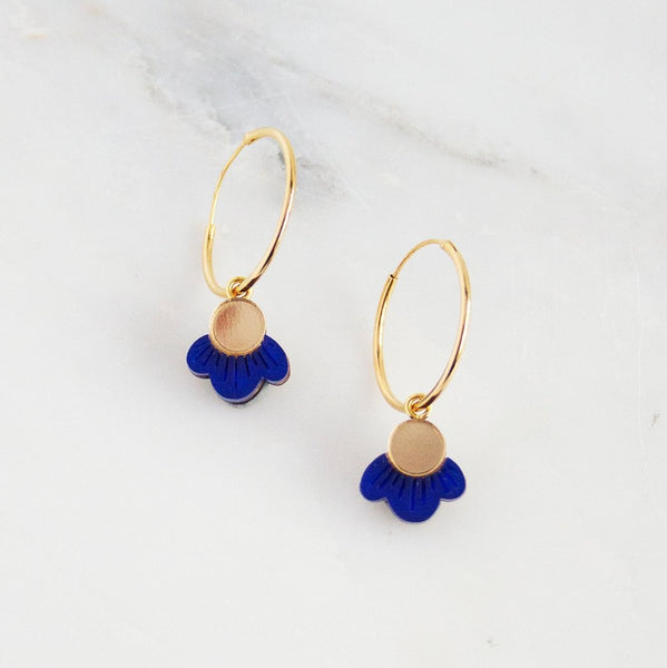 Delicate handmade wildflower hoop earrings made with gold mirror and shades of blue.  Wear the essence of a Mediterranean summer with our Garden Collection. Perfect for both daytime and evening.   Comes in a W&M cotton gift pouch.  Handmade in North London.