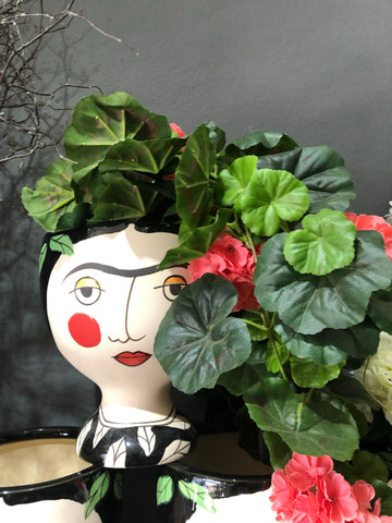 Freida kahlo face vase and flowers