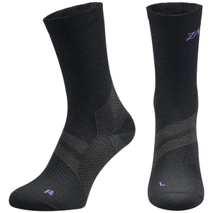 A pair of black Merino Wool Edition by ZaTech® socks on white background. Front left and center angle..