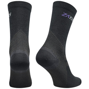 A pair of black Merino Wool Edition by ZaTech® socks on white background. Back left angle.
