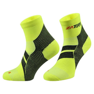 A pair of yellow Quarter Cut Edition by ZaTech® socks on white background.