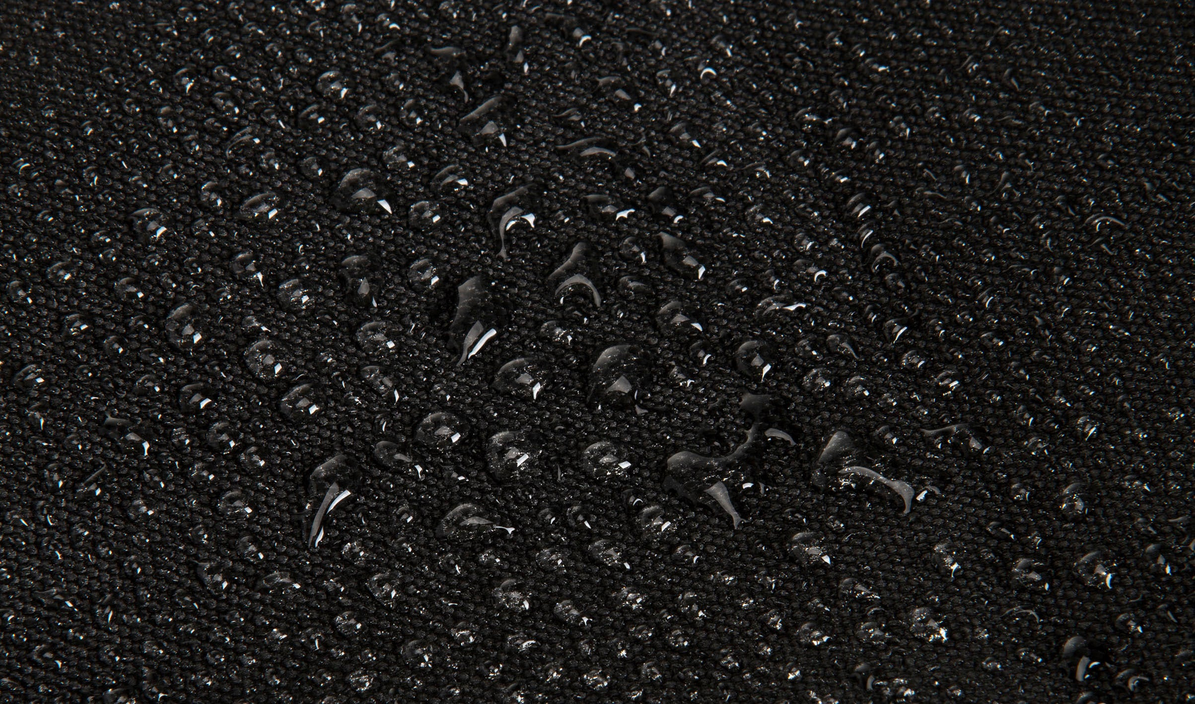 water resistant scuba material with water droplets