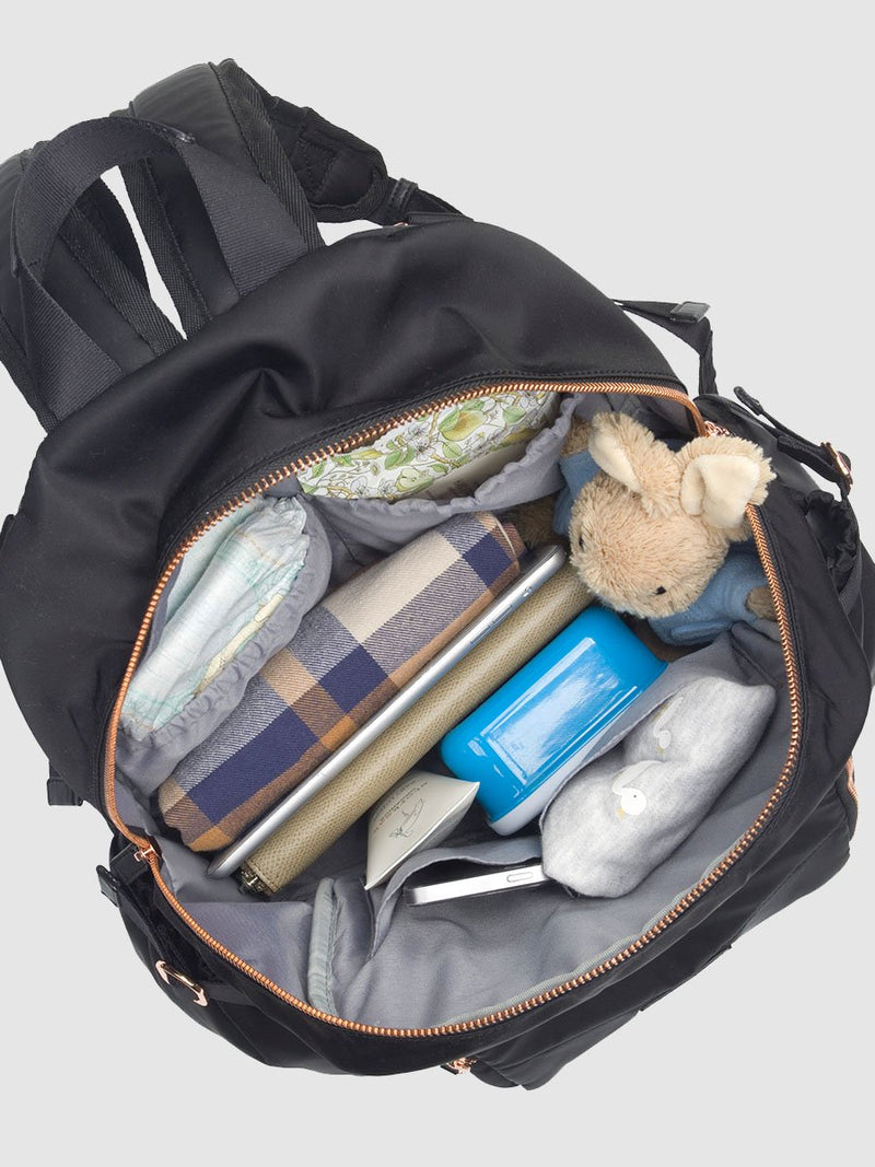 storksak hero quilt black, changing bag backpack, in quilted nylon with rose gold hardware, main internal full of baby clothes, nappies etc