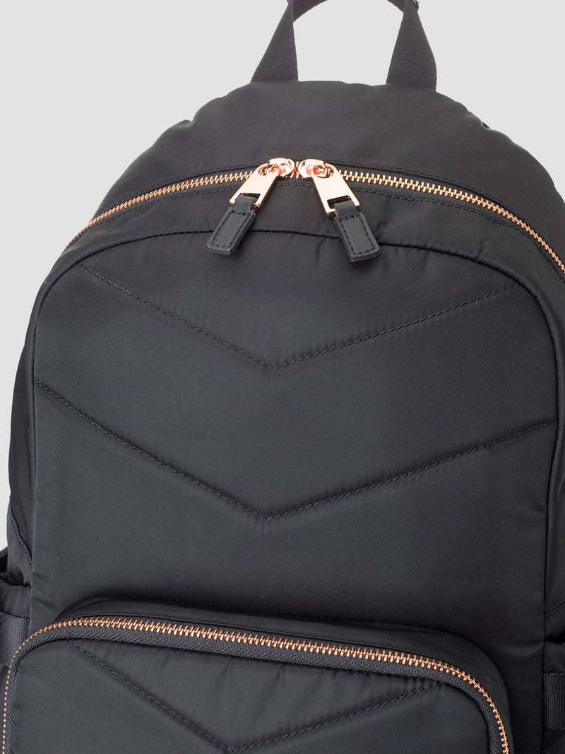storksak hero quilt black, changing bag backpack, in quilted nylon with rose gold hardware, close up of wide opening and double zip pull