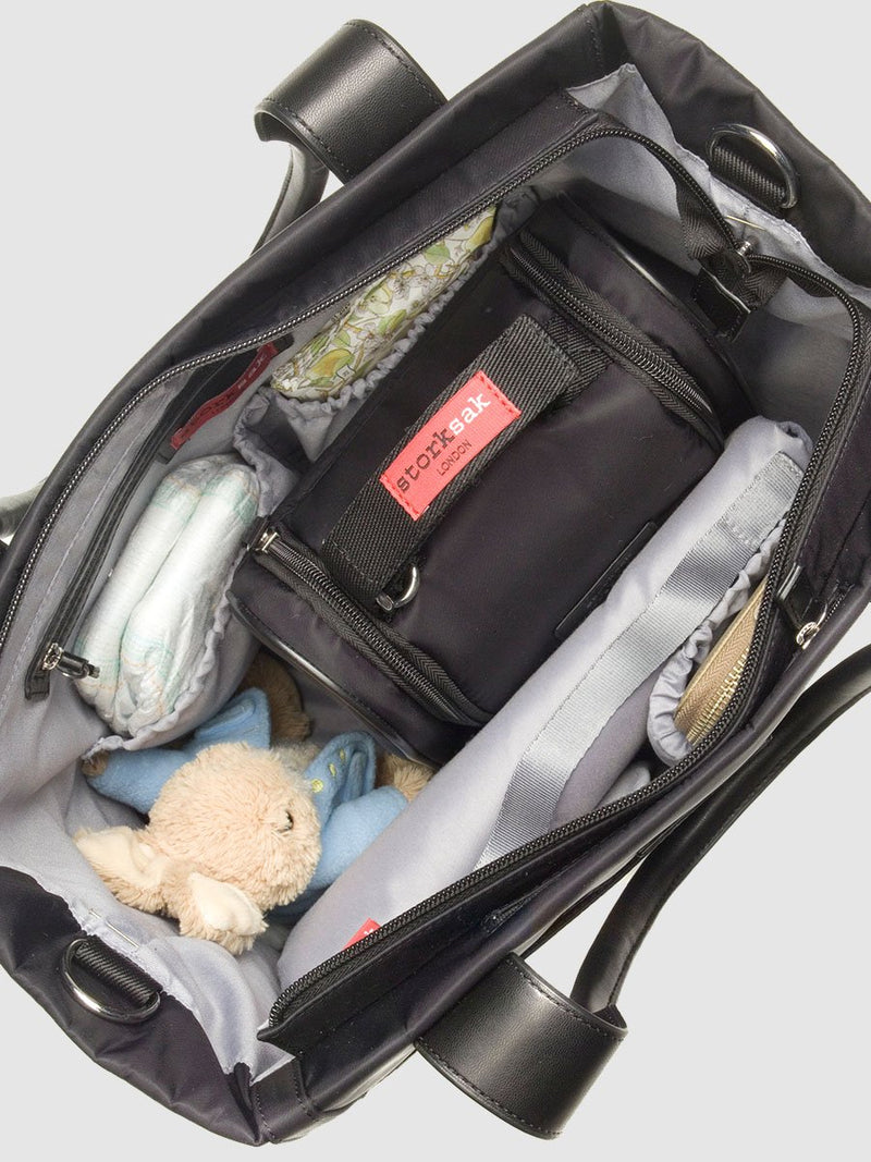 Storksak Eliza Black Changing Bag, tote shape, inside view filled with baby items