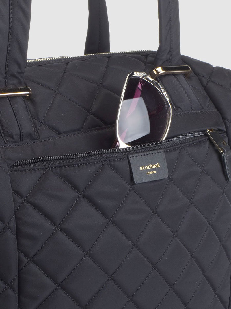 storksak stevie quilt black, changing bag, close up of front pocket & nylon material