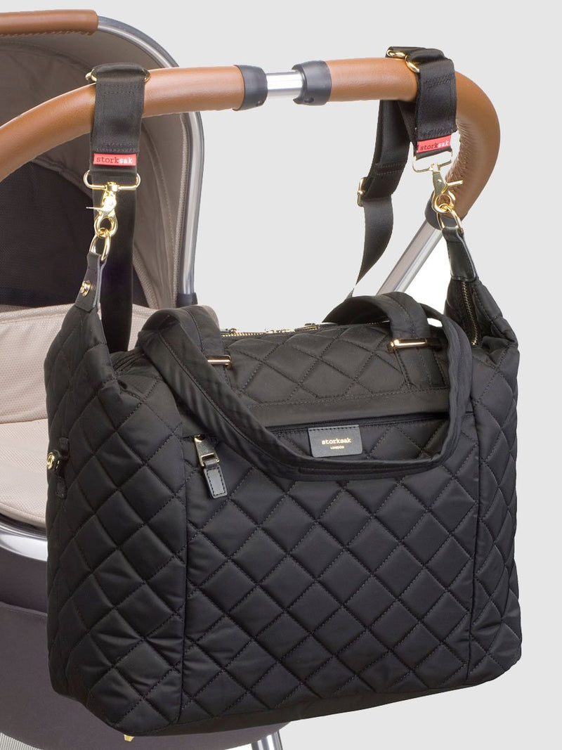 storksak stevie quilt black, changing bag, attached to pram with stroller straps