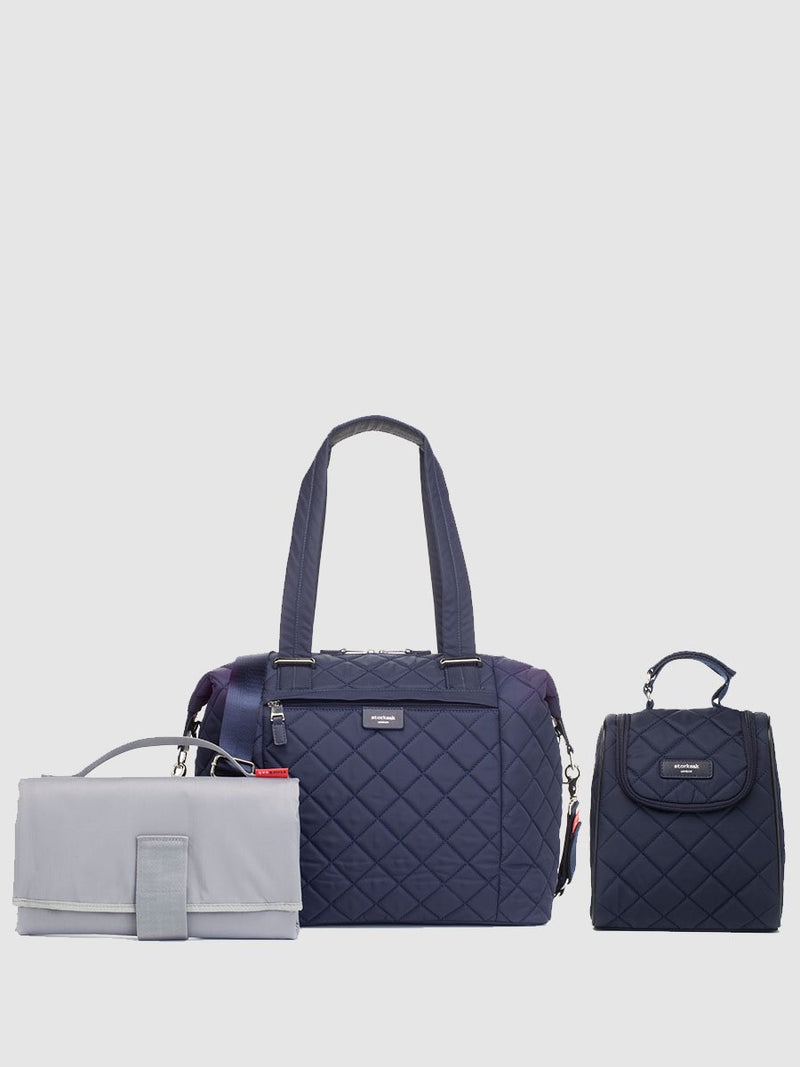 storksak stevie quilt navy, changing bag, comes with changing mat, stroller straps and insulated bottle holder