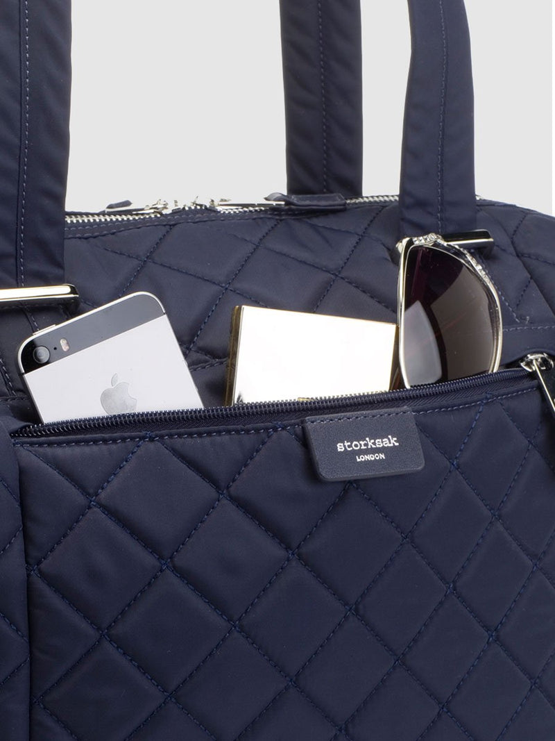 storksak stevie quilt navy, changing bag, close up of front pocket and nylon material