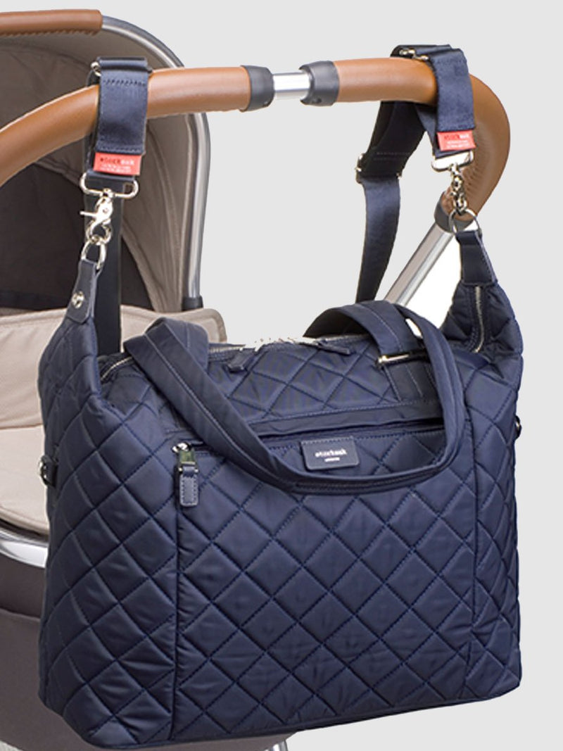 storksak stevie quilt navy, changing bag, attached to pram with stroller straps