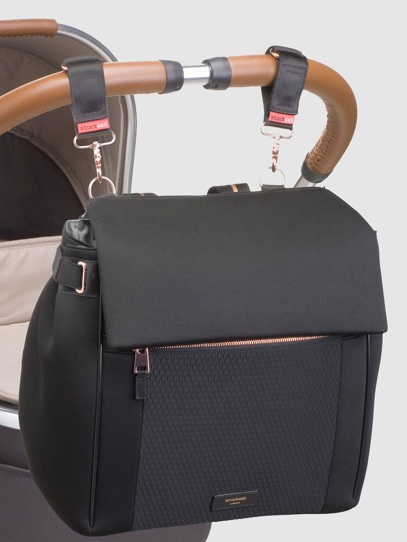 storksak st james scuba black, convertible changing bag, attached to pram with stroller clips