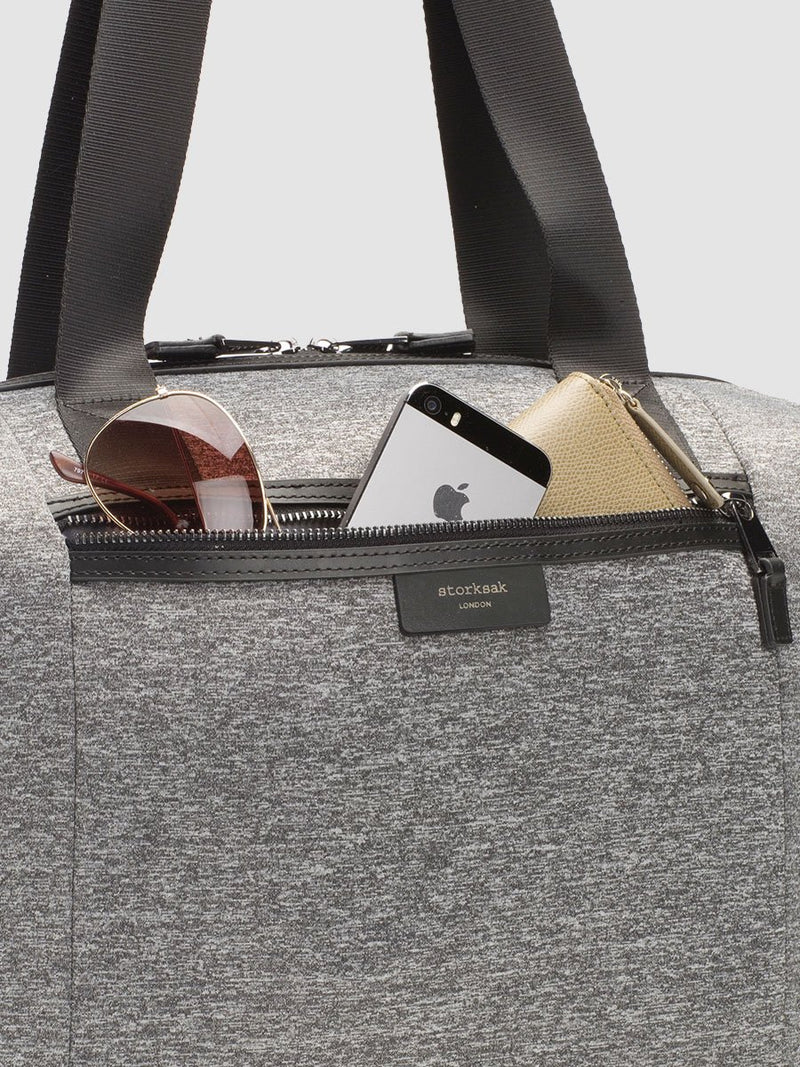 storksak stevie luxe scuba grey marl, changing bag, close up of front pocket with gunmetal trim
