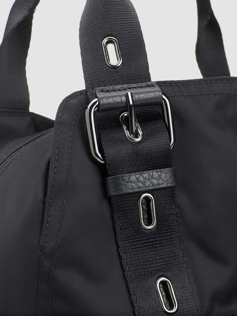storksak alexa luxe  black changing bag, close up of gunmetal hardware and leather trim