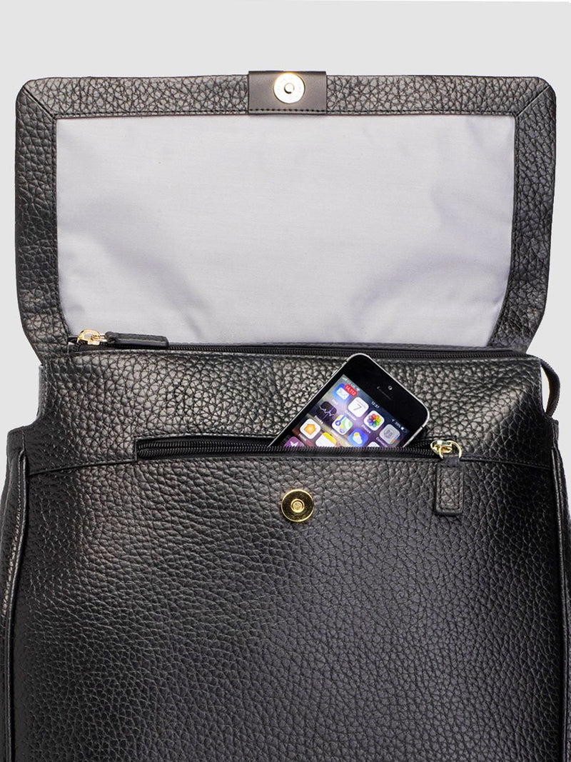 storksak st james leather black, luxury convertible changing bag, flap open with hidden phone pocket showing