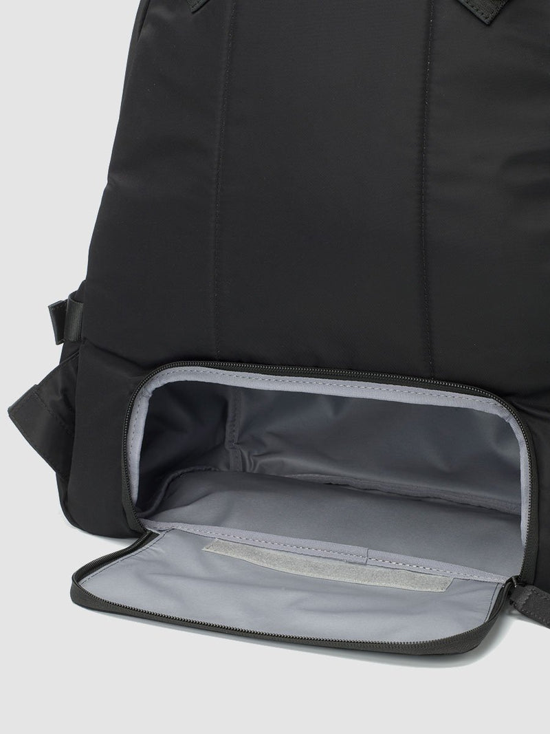 Storksak Hero Black backpack changing bag, back view showing zipped opening for lower compartment